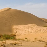 The Great Wall engulfed by sand from the Tengger desert.
