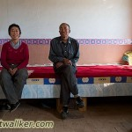 "This lovely couple offered me to spend the night on their ""Kang"". A bed with a small stove underneath to keep the heat during the cold winter months. I thanked them for the kind offer, but wanted to walk further that day."