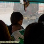 Mother and child on a crowded bus.
