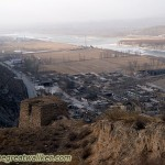 Here the Great Wall climbs along the edge of a ridge. The Yellow River flowing by to the right.