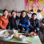Three generations of a family in Inner Mongolia. They were very nice and offered me to share a hot meal with them.