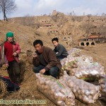 Farmers retrieving potatoes from a storage cave under the Great Wall. The woman kindly asked if I wanted to eat with them, but it was still early in the day, so I needed to push on.