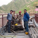 These workers were doing repairs to a dam, but let me over to the other side so I could follow the Great Wall.