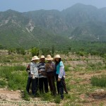 Farmers reading a 'business card' I bring along while walking the Great Wall.