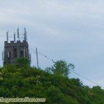 I have seen several watchtowers covered by mobile phone antennas.
